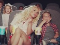 The star goes to the cinema with her sons in a new still from the clip.