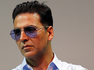 Akshay Kumar listens during a press conference for Bollywood's new film Housefull 2 which makes its world premiere Tuesday, April 3, 2012 in Singapore.