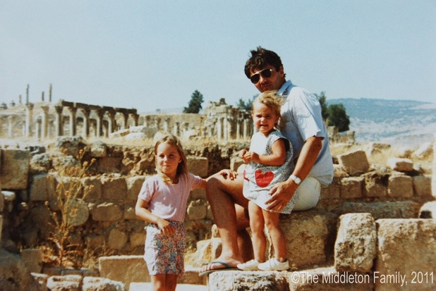 Catherine aged four with her father and sister Pippa in Jerash, Jordan.