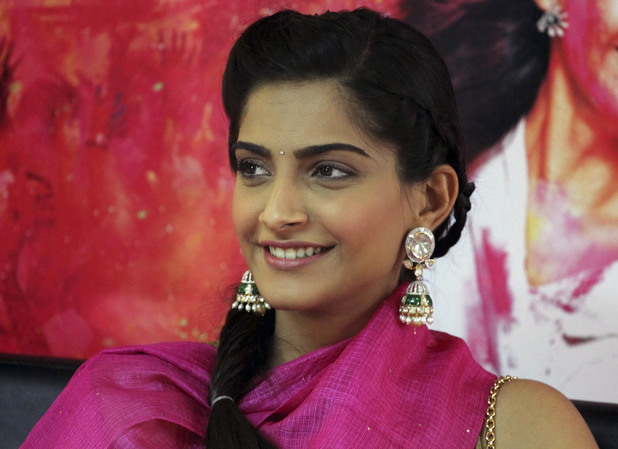 Sonam Kapoor smiles during a press conference