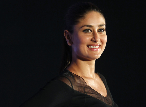 Kareena Kapoor poses for the media during the launch of a new range of Sony Vaio laptops in Mumbai, India, Wednesday, June 6, 2012.
