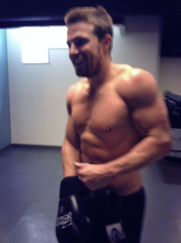 Stephen Amell, Facebook, shirtless, caption: Arrow boot camp. Day 1. Session 1 of 2. James Bamford almost destroyed me.