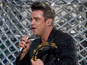 Robbie Williams stages surprise London gig