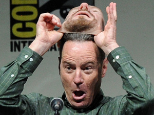 Actor Bryan Cranston pulls off his Walter White mask onstage at the 'Breaking Bad' panel during Comic-Con International 2013 at San Diego Convention Center on July 21, 2013 in San Diego, California