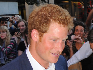 Prince Harry leaves Getty Images Gallery in London and was given a present for his nephew Prince George of Cambridge