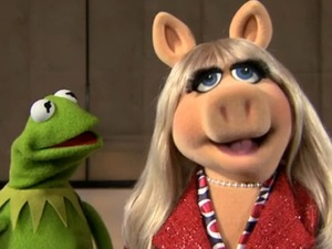 Kermit the Frog and Miss Piggy of The Muppets.