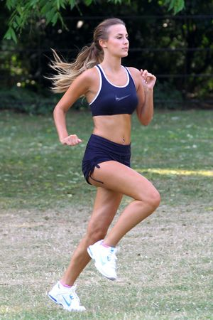 Lucy Watson, exercising in Battersea Park, London