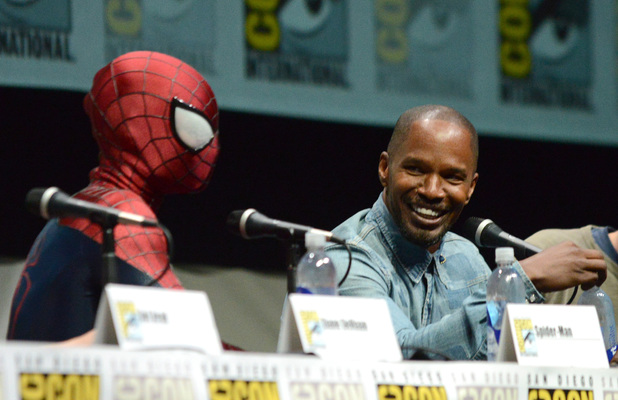 Spider-Man, left, and Jamie Foxx attend the