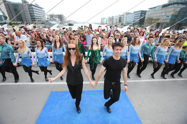 Jean Butler and Padraic Moyles lead the cast of Riverdance on Samuel Beckett Bridge, during the world record attempt for the longest line of Irish dancers in Dublin.