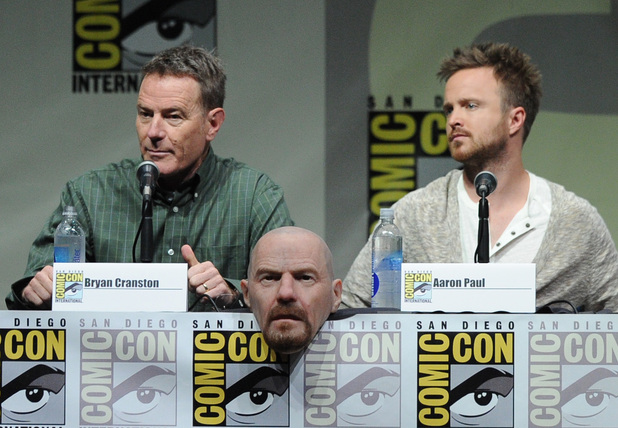 Actors Bryan Cranston (L) and Aaron Paul speak onstage at the 'Breaking Bad' panel during Comic-Con International 2013 at San Diego Convention Center on July 21, 2013 in San Diego, California