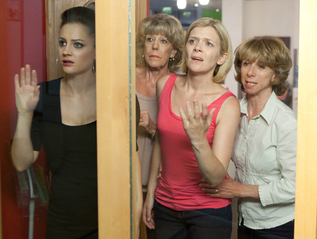 Gail, Leanne, Kylie and Audrey can only watch on as Nick is wheeled past them.