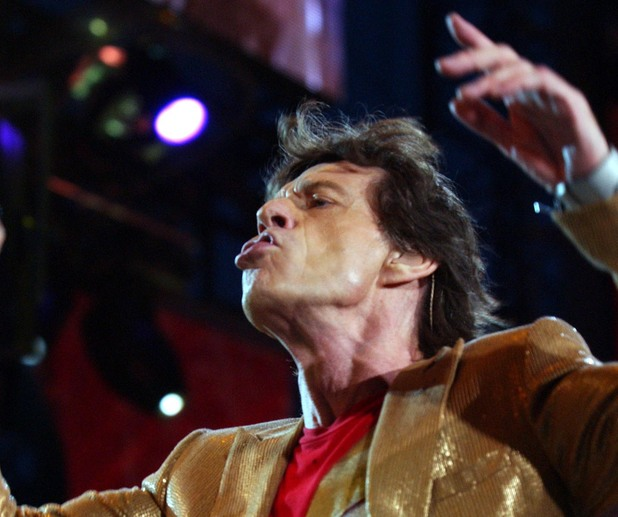 Lead singer Mick Jagger and the Rolling Stones performing on stage, during their Forty Licks World Tour, held at the Twickenham Rugby Stadium, London. 2003