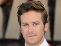 Armie Hammer looks red hot in red suit at The Lone Ranger premiere.