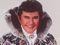 "Tony Palmer says that Liberace never ""minced"" across the stage."