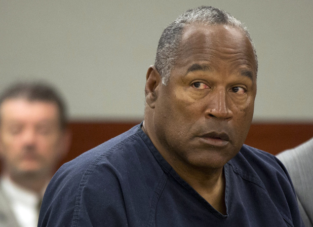 O.J. Simpson listens during an evidentiary hearing in Clark County District Court, Thursday, May 16, 2013 in Las Vegas
