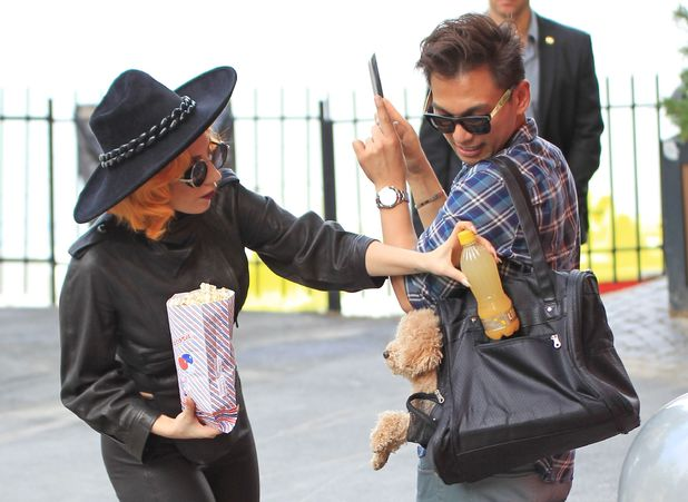 Lady GaGa, popcorn, dog, assistant, Bucharest, Romania - 17 Aug 2012