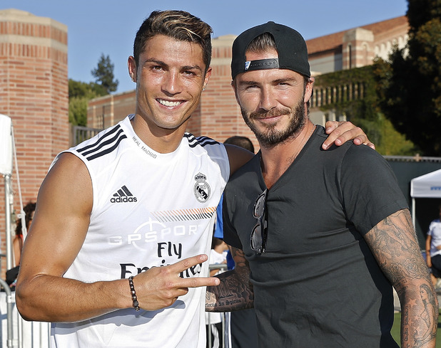 Cristiano Ronaldo of Real Madrid and former player David Beckham pose after a training session at UCLA Campus