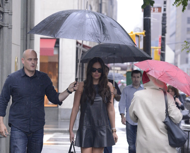Tamara Ecclestone In The Rain Caption: 	Tamara Ecclestone shelters under an umbrella from the rain in Manhattan