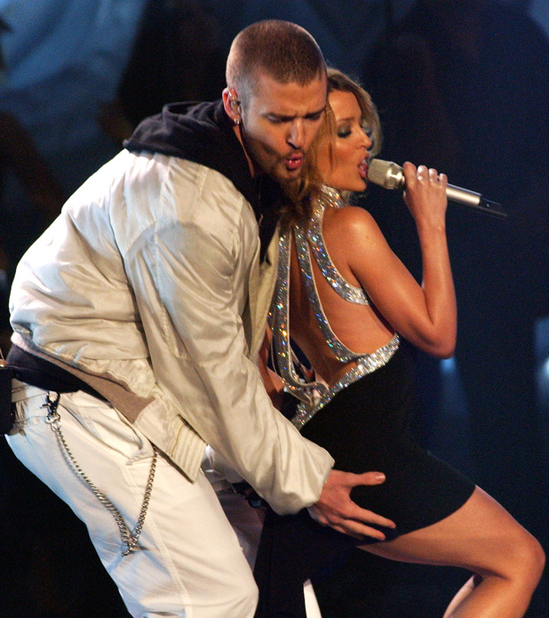 Singers Justin Timberlake and Kylie Minogue performing on stage during The Brit Awards 2003 at Earls Court 2, London