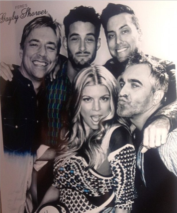 Fergie poses with friends at her baby shower