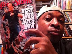 Chuck D of Public Enemy holding a copy of Rolling Stone