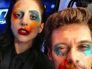 Lady GaGa, face paint, Ryan Seacrest, caption: One of us was born this way, one of us needed to be touched up.