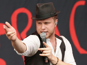 Olly Murs performing on the Virgin Media Stage during day two of the V Festival at Hylands Park in Chelmsford.