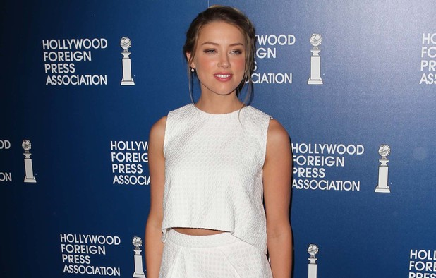 Amber Heard at the Hollywood Foreign Press Association's 2013 Installation Luncheon, LA