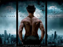The poster features Aamir Khan looking out at a city skyline.