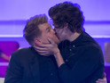Watch the moment the One Direction star and the comedian kiss.