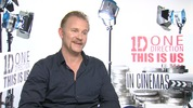 'Super Size Me' director Morgan Spurlock talks to Digital Spy about directing 'This Is Us', working with Simon Cowell and what access he had to the biggest boyband on the planet right about now.