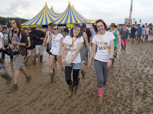 Festival-goers in the mud at Leeds 2013