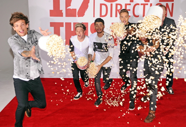 'One Direction: This Is Us' film photocall, London, Britain - 19 Aug 2013 One Direction - Louis Tomlinson, Niall Horan, Zayn Malik, Liam Payne and Harry Styles throwing popcorn at the photographers 19 Aug 2013