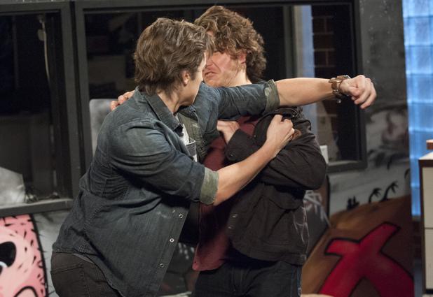 Mason punches Robbo.