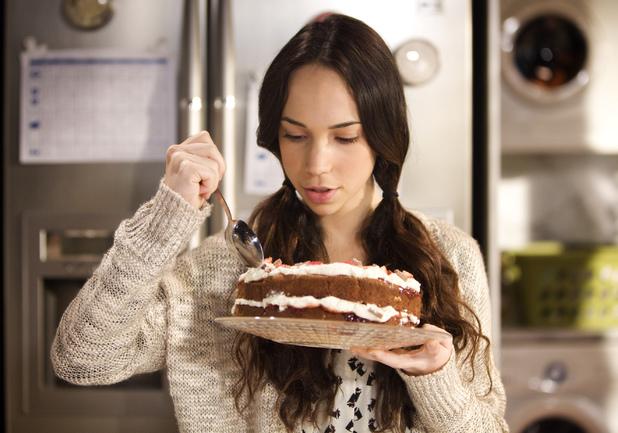Home alone, Imogen starts to binge eat.