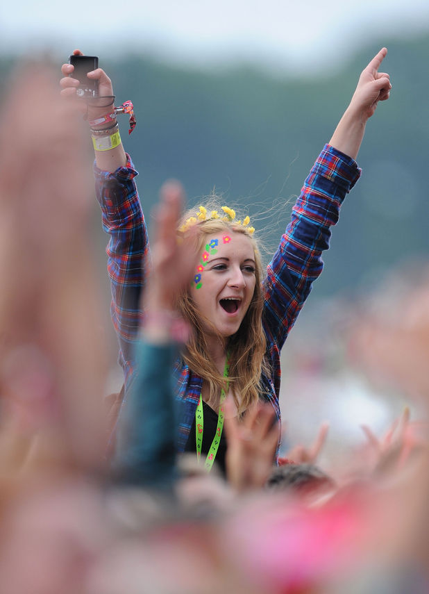 Festival goers watch Olly Murs on the Virgin Media stage during day one of the V Festival at Weston Park in Weston-under-Lizard.