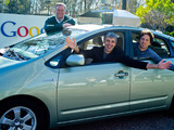 Google's Eric Schmidt, Larry Page and Sergey Brin in a self-driving car in 2011