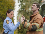 Natalie Martinez as Deputy Linda and Josh Carter as Rusty in Under The Dome S01E01