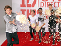 One Direction enjoy popcorn fight at This Is Us movie photo-call in London.