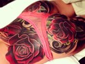 The large tattoo of English roses took three 7-8 hour sessions.