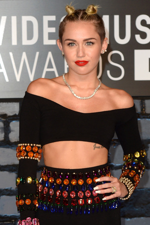 Miley Cyrus arrives at the MTV Video Music Awards 2013