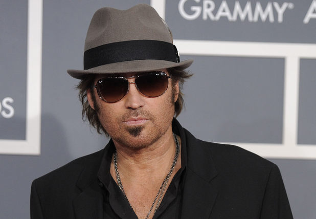Billy Ray Cyrus arrives at the 54th annual Grammy Awards on Sunday, Feb. 12, 2012 in Los Angeles.