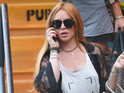 Lindsay Lohan snaps a photograph of designer Tal Cooperman asleep in bed.