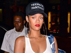 Rihanna, sheer white top, cut-off denim shorts, baseball cap