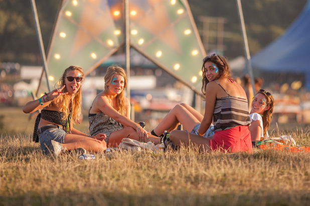 Festival-goers at sunset on Thursday