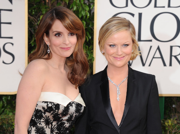 Tina Fey and Amy Poehler arrive at the 70th Annual Golden Globe Awards.