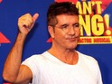 "Cowell is glad he no longer has to ""hide"" his joy at becoming a father."