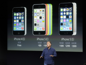 Phil Schiller, Apple's senior vice president of worldwide product marketing, speaks on stage during the introduction of the new iPhone 5c and 5s.