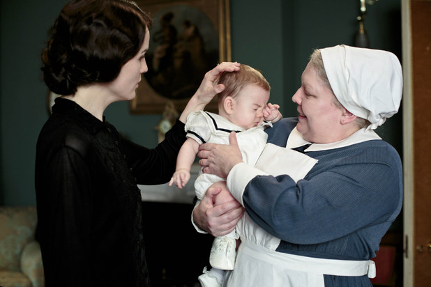 Michelle Dockery as Lady Mary, Baby George and Di Botcher as Nanny West in Downton Abbey series 4.