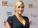 Kate Winslet reveals huge baby bump at Labor Day screening.